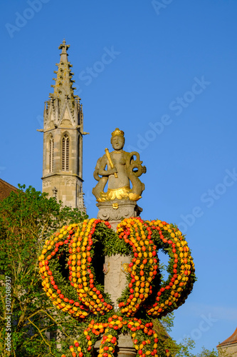 Foto op Aluminium Historisch mon. Decorated Herrngasse column against town hall tower in Bavaria, Germany