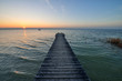 Sunset on wooden jetty over lake Ammersee Bavaria, Germany