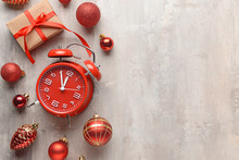 Alarm Clock And Decor On Light Background. Christmas Countdown Concept