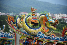 Yilan City, Taiwan - May 12 2017: Close Up Of A Colorful Dragon On An Orange Rooftop Of A Taiwanese Temple