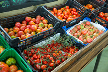 Boxes With Tomatoes In Grocery...