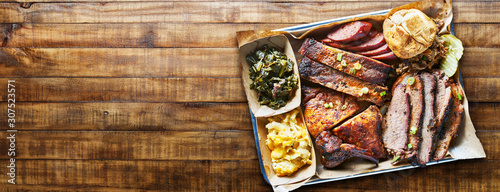 Fototapeta texas bbq platter on wooden table in copy space composition obraz