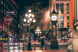 canvas print picture - The famous Steam Clock in Gastown in Vancouver city with cars light trails at night