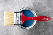 Can Of Classic Blue Paint With...