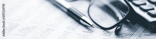 Close-up Pen Calculator And Reading Glasses On Financial Report - Business Acco Wallpaper Mural