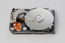 Hard Drive Disassembled On A Gray Background Top View