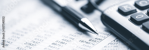 Close-up Pen Calculator And Reading Glasses On Financial Report - Business Accou Canvas Print