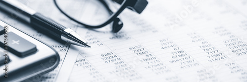 Close-up Pen Calculator And Reading Glasses On Financial Report - Business Accou Wallpaper Mural
