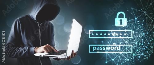 Fényképezés Hacker with laptop. Computer crime.