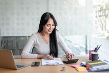 Business Women Using Calculato...