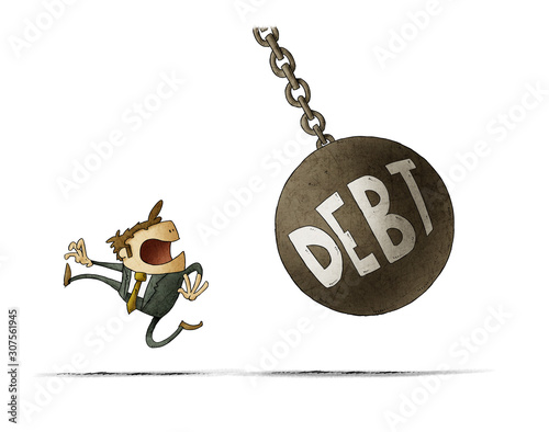 Fototapeta Businessman runs because a big ball with the word debt is going to hit him