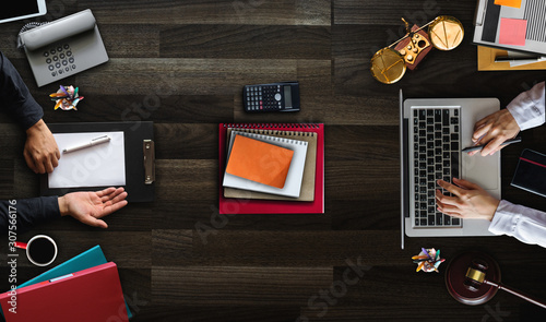 Top view Business and lawyers discussing contract papers with brass scale on desk in office Wallpaper Mural