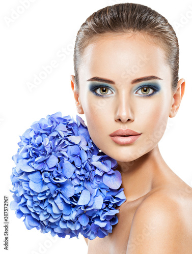 Portrait of young beautiful woman with a healthy clean skin of the face
