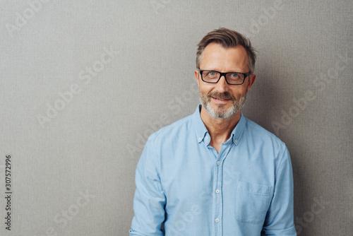 Obraz Portrait of an attractive bearded middle-aged man - fototapety do salonu