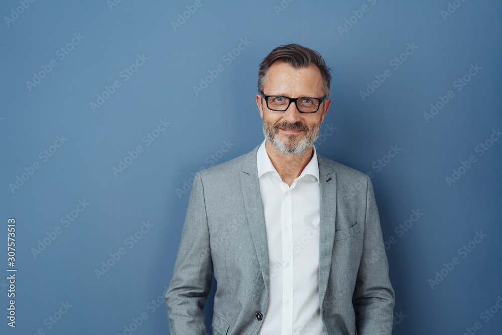 Fototapeta Smiling friendly professional man wearing glasses