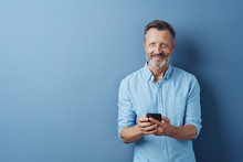 Happy Relaxed Man Holding His Mobile Phone