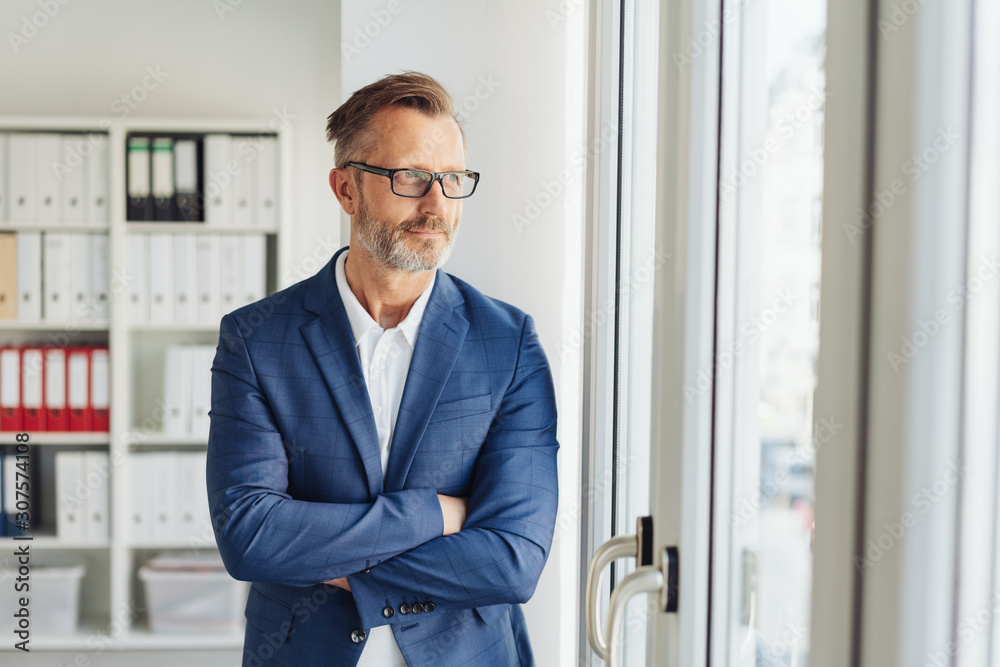 Fototapeta Confident thoughtful businessman standing waiting