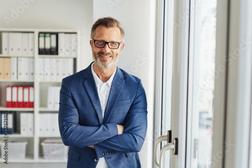 Obraz Confident stylish businessman with friendly smile - fototapety do salonu
