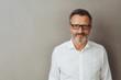 Leinwandbild Motiv Portrait of man in glasses and white shirt