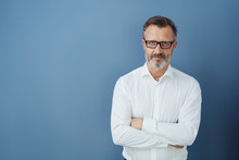 Man In Glasses And White Shirt With Arms Crossed