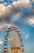 Ferris Wheel Touching The Fluffy Clouds