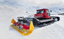 Groomer Red And Yellow Parking On Ski Slope In Alpine Resort