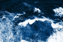 Top View On Blue Ocean Waves A...