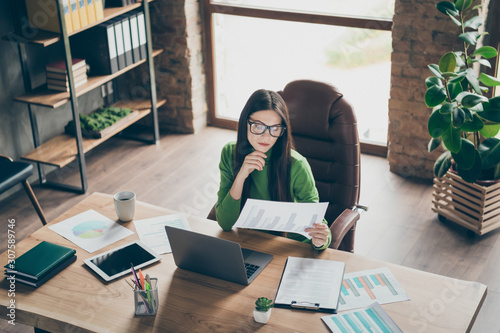 Fotomural  High angle view photo of pretty business lady holding paper list analyzing compa
