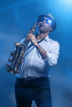 Man Playing Sax In Cold Blue L...
