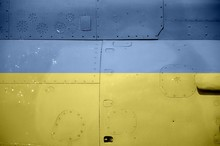 Ukraine Flag Depicted On Side Part Of Military Armored Helicopter Closeup. Army Forces Aircraft Conceptual Background