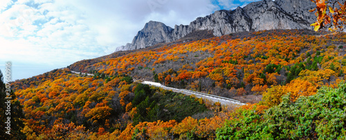 Beautiful autumn landscape with a road and mountains
