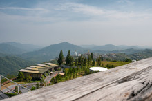 Wooden Plank On Iconic Resort With Statue Buddha On Hill In Khao Kho