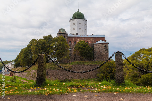A fence of chains on the background of Vyborg Castle in overcast day, Vyborg, Le Wallpaper Mural