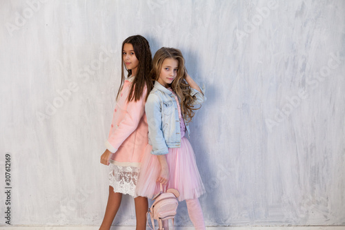 Portrait of two beautiful fashionable girl girlfriends in white pink clothes Wallpaper Mural