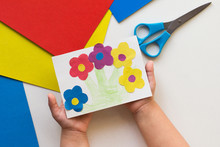 Handmade Greeting Card With Flowers In Child Hands On White Background
