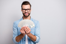 Photo Of Attractive Handsome Guy Holding Fan Of American Money Dollars Successful Freelancer Rich Person Wear Specs Casual Denim Outfit Isolated Grey Color Background
