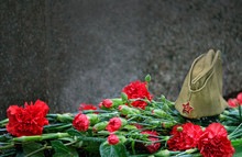 9 May, Victory Day Background. Holiday Victory Day May 9, 1945. Flowers And Military Cap, Symbol Of May 9, Memory Of War. Copy Space