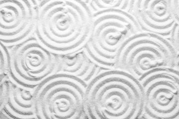 Fototapeta na wymiar White sand with pattern as background, top view. Zen, meditation, harmony