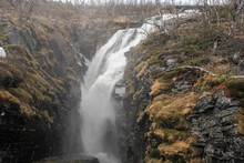Turbulent Waterfalls Flow Down Into The Lake