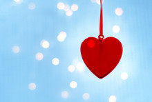 Hanging Christmas Heart Toy On On A Glowing Colorful Background