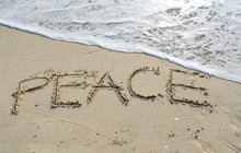 """""""PEACE"""" Written And Footprint In The Sand ."""