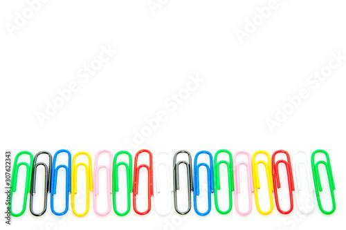 Vászonkép Colored paper clips on a white background.