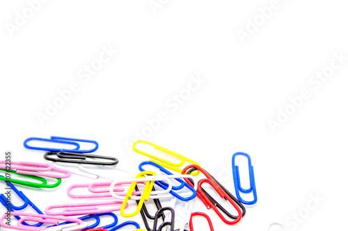 Fényképezés Scattered paper clips on a white background.