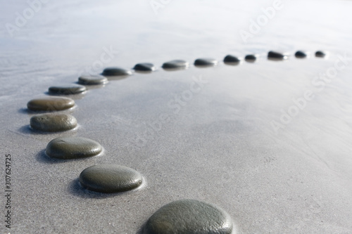 Fotografie, Obraz concept shallow depth of field black  stepping stones pebbles in shallow water w