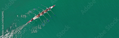 Fotografie, Obraz Aerial drone top panoramic view of sport canoe rowing synchronous athletes compe