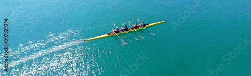 Obraz na plátně Aerial drone top panoramic view of sport canoe rowing synchronous athletes compe