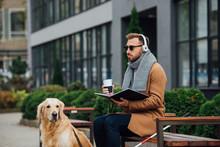 Blind Man In Headphones Holdin...