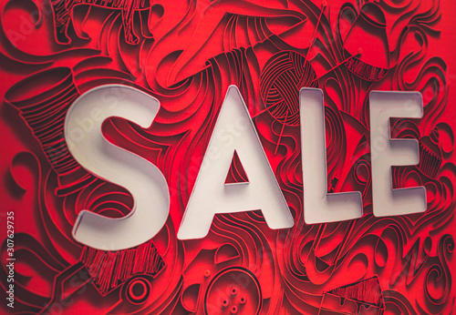 red artistic background of a shopfront saying sale Canvas-taulu