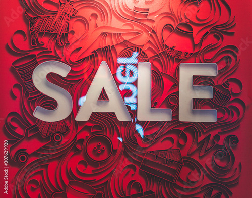 Valokuva red artistic background of a shopfront saying sale