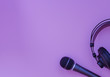 canvas print picture - Microphone and headphone on a purple background